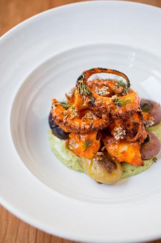 Spicy Grilled Octopus Fermented Chile, Crispy Garlic, Crispy Potatoes, Cilantro Aioli
